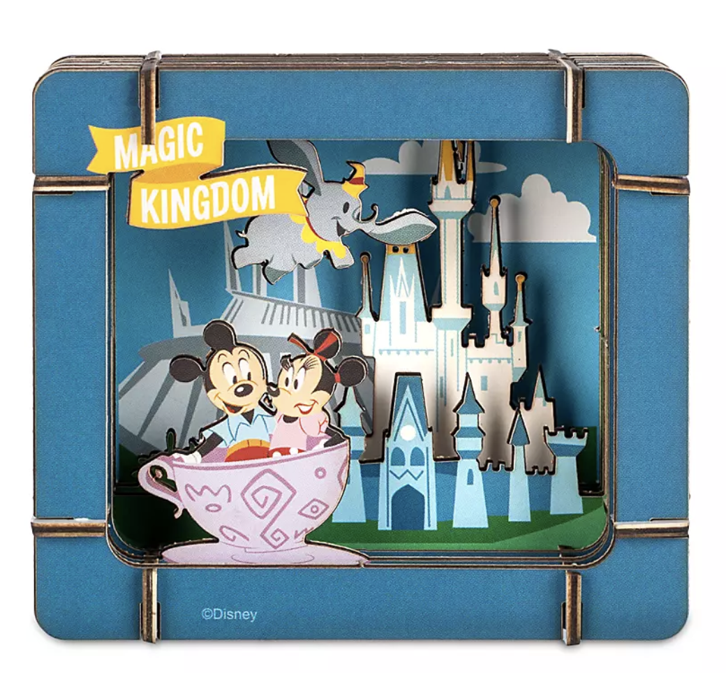a diorama kit with a display of cinderella castle, dumbo, and mickey and minnie in a teacup ride