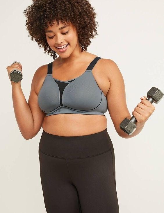 model wearing grey and black sports bra