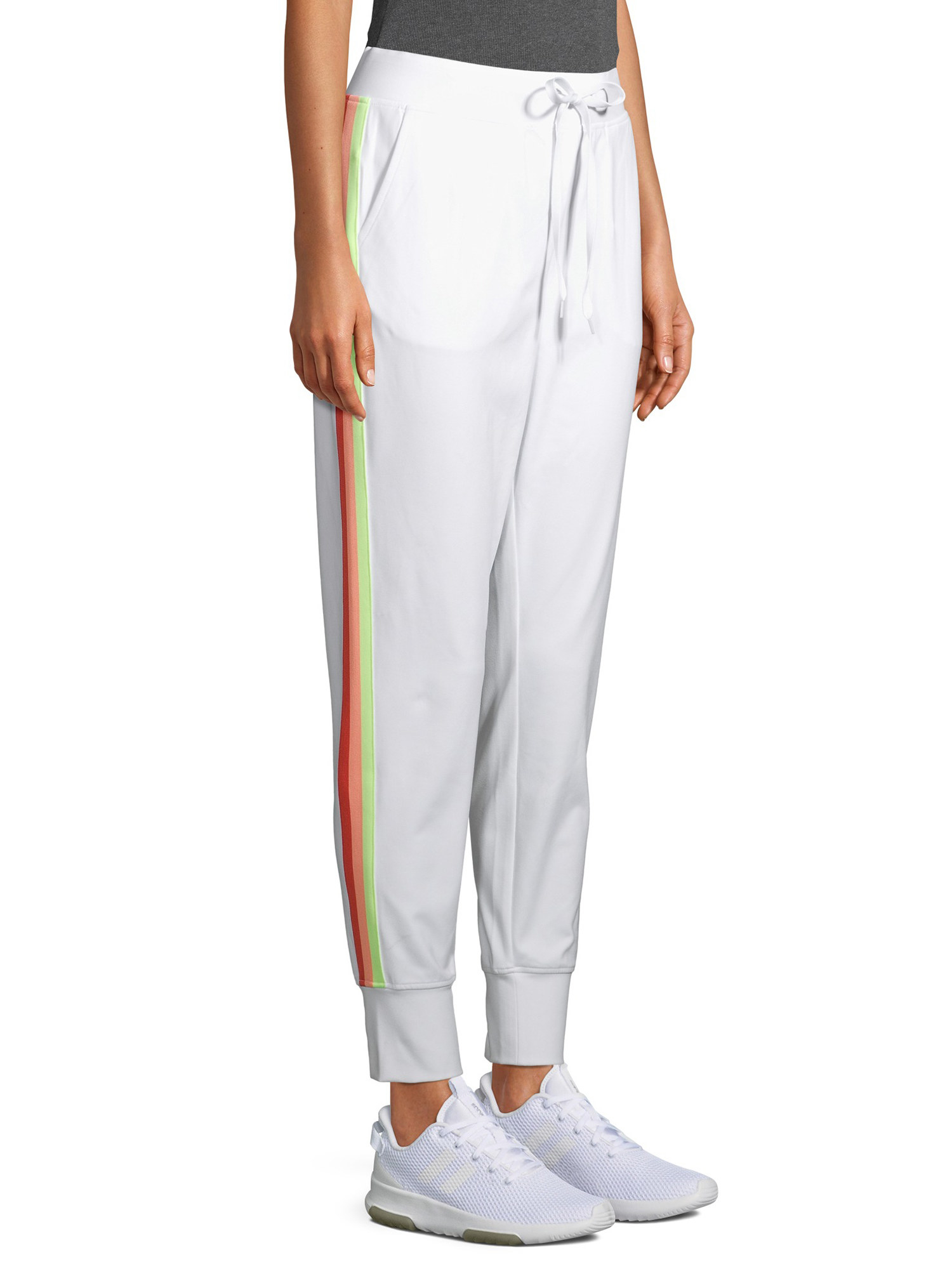 The white sweatpants with rainbow side stripes