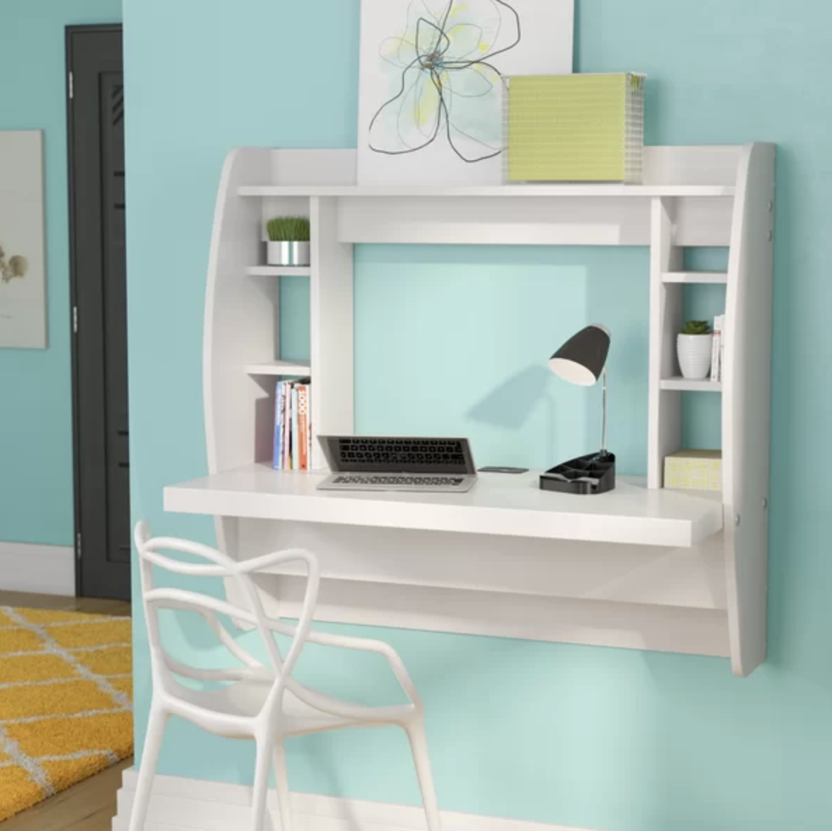 the wall desk in white with six small shelves and a large top shelf