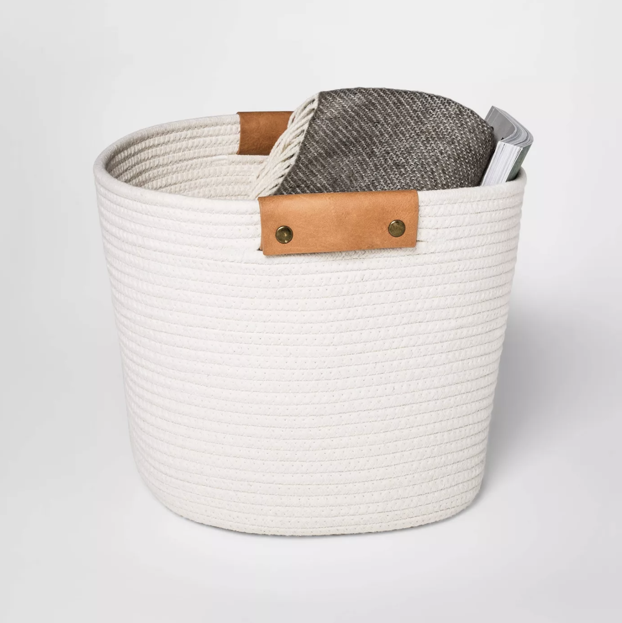 white woven basket with brown faux leather accents