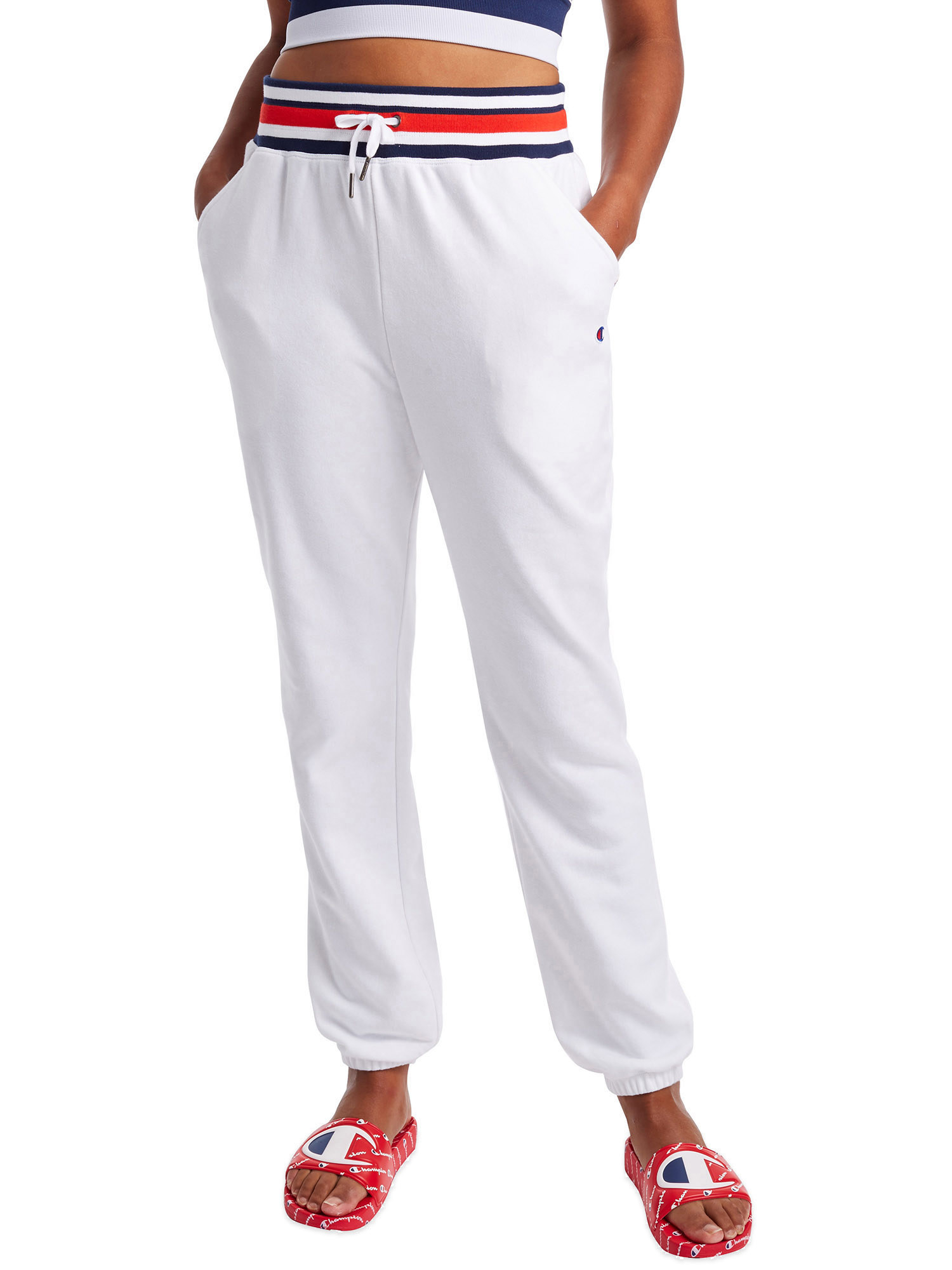 The white sweatpants with red, blue, and white striped waistband