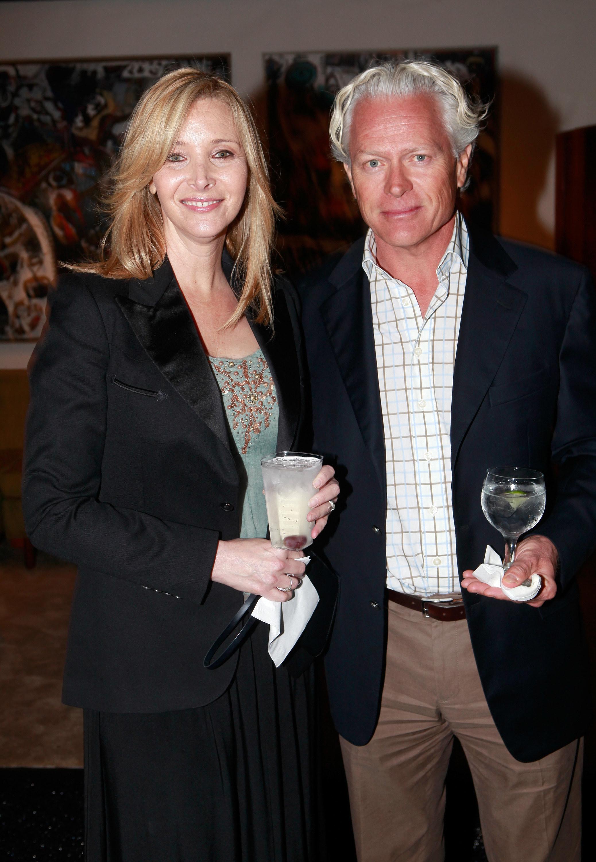 smiling together while holding beverages
