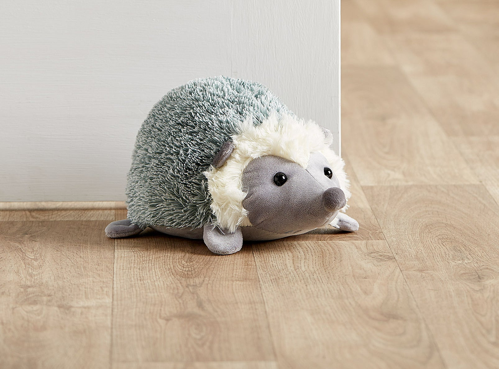 A hedgehog holds open a door