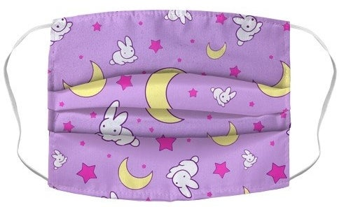 Purple face mask with pink stars, yellow moons, and white bunnies