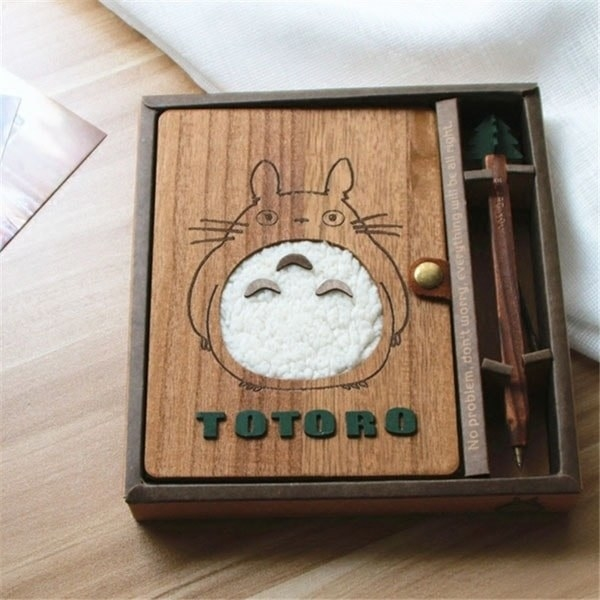 the wooden journal with a plush totoro on the front