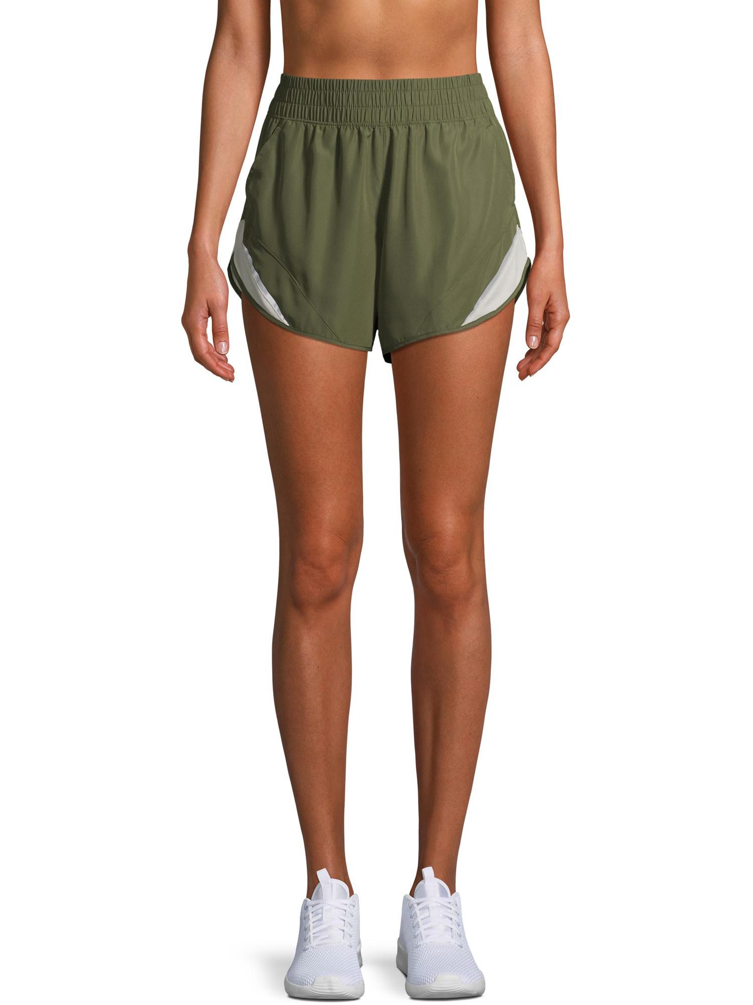 model wearing olive green running shorts