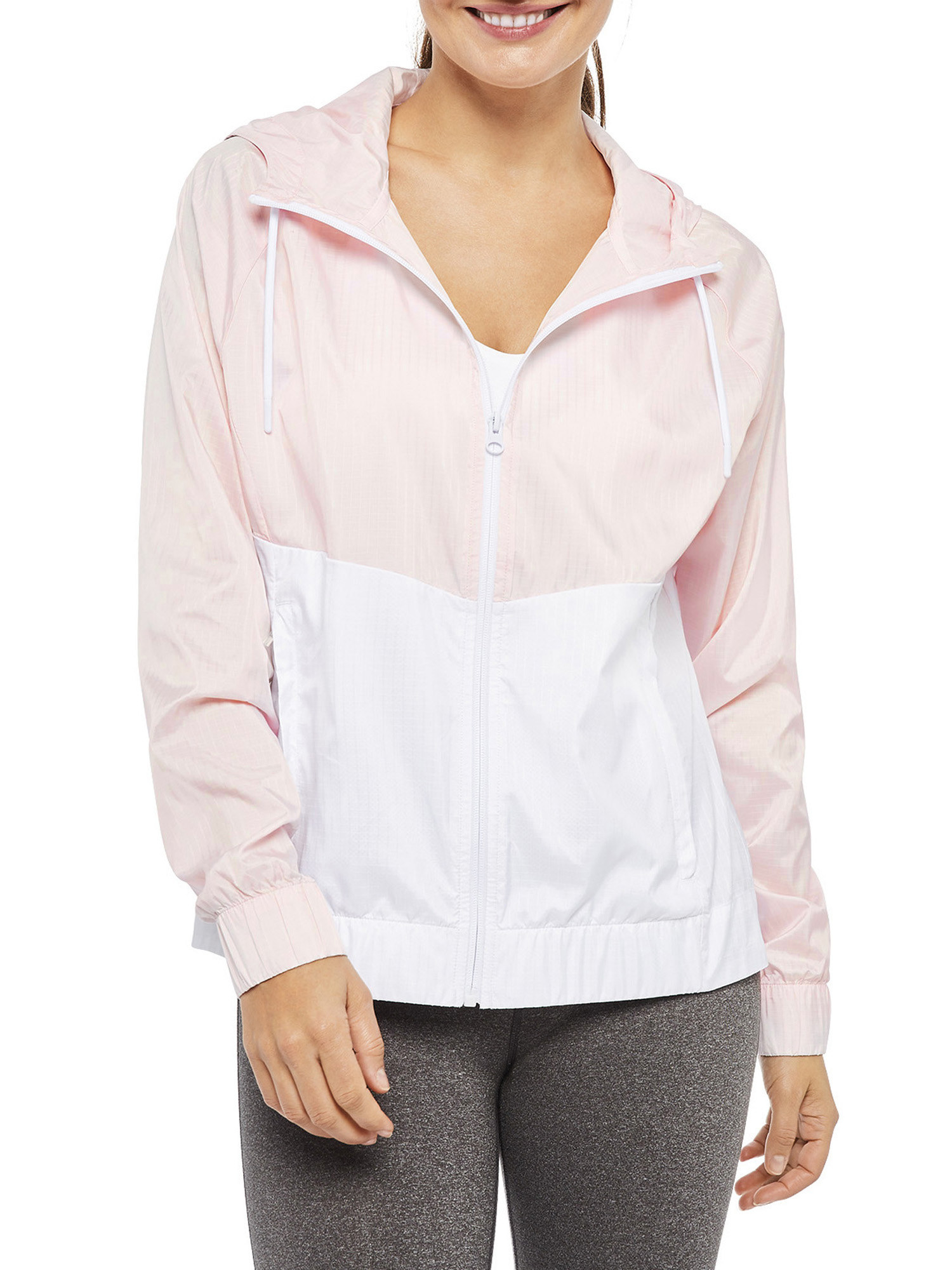 model wearing light pink and white zip-up hoodie