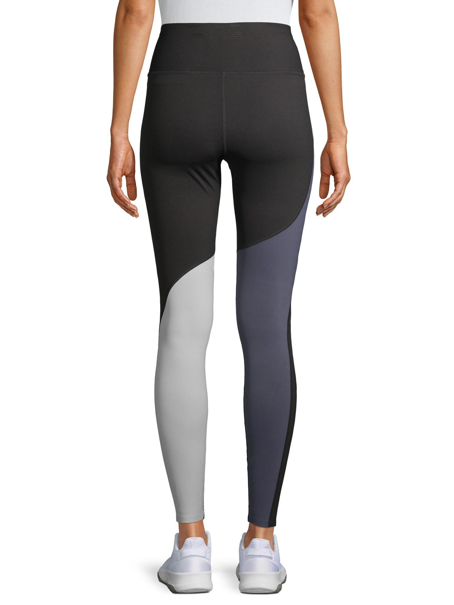 model wearing light and dark gray leggings