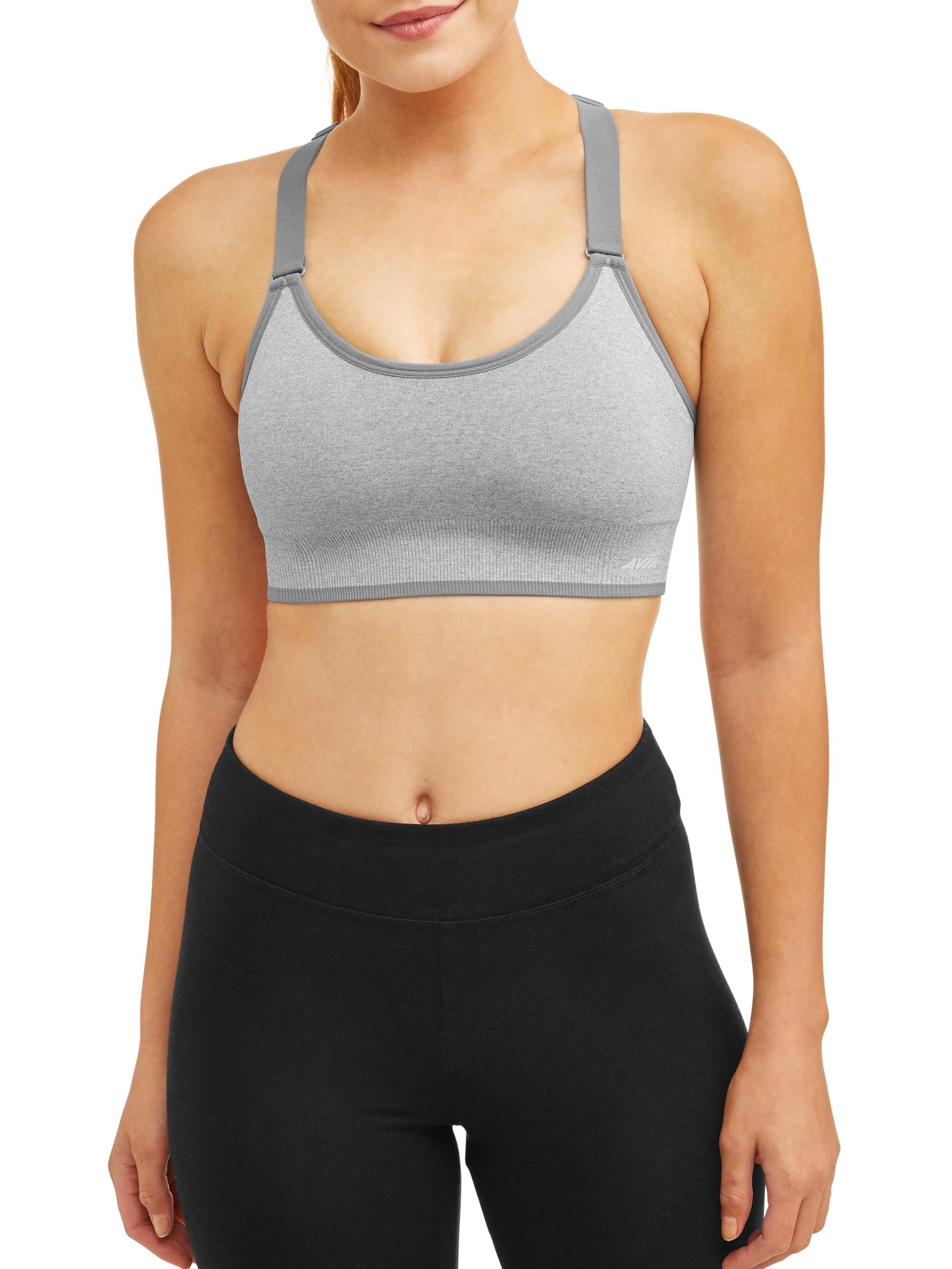 model wearing light gray sports bra