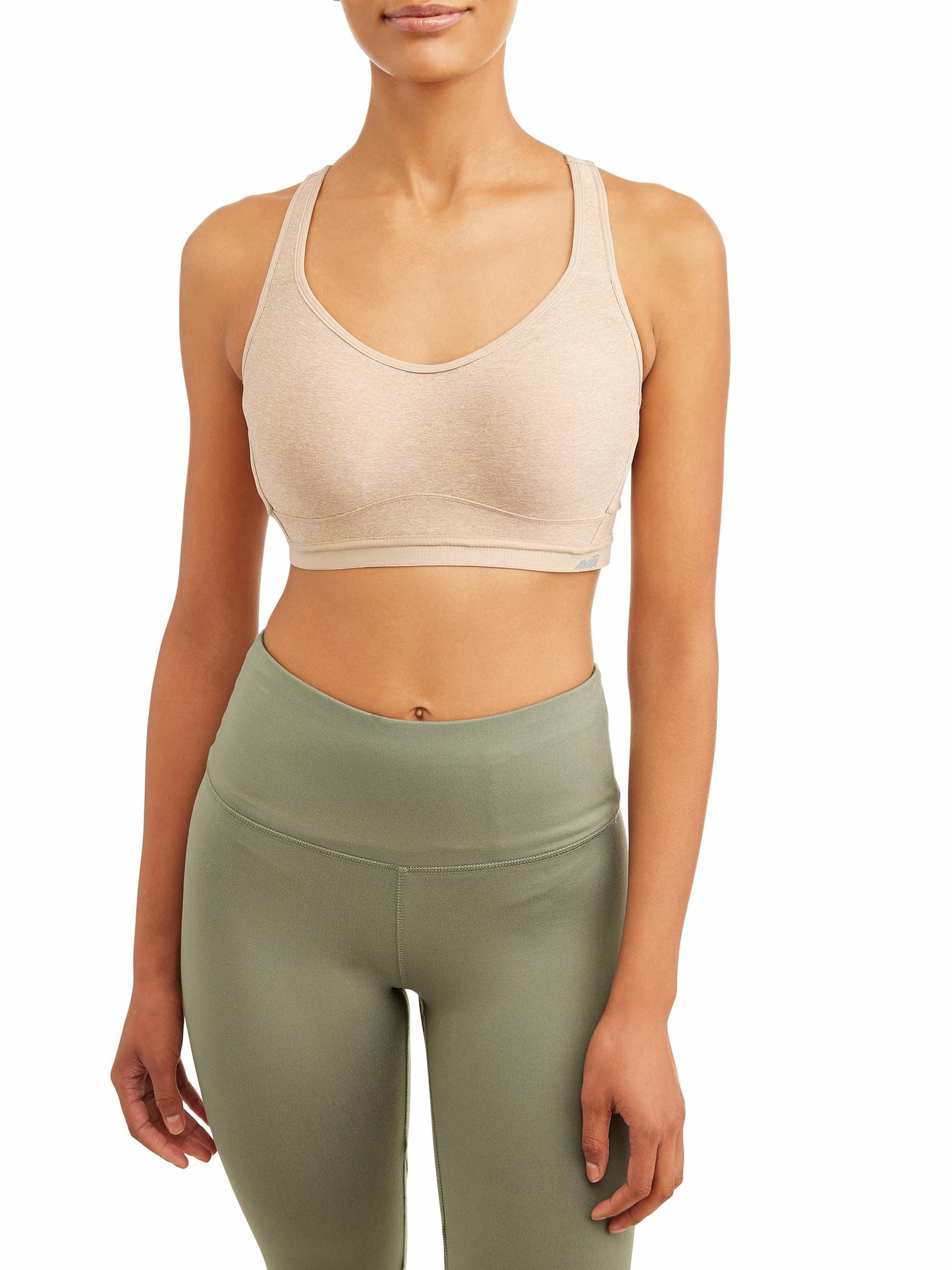 model wearing fawn beige sports bra