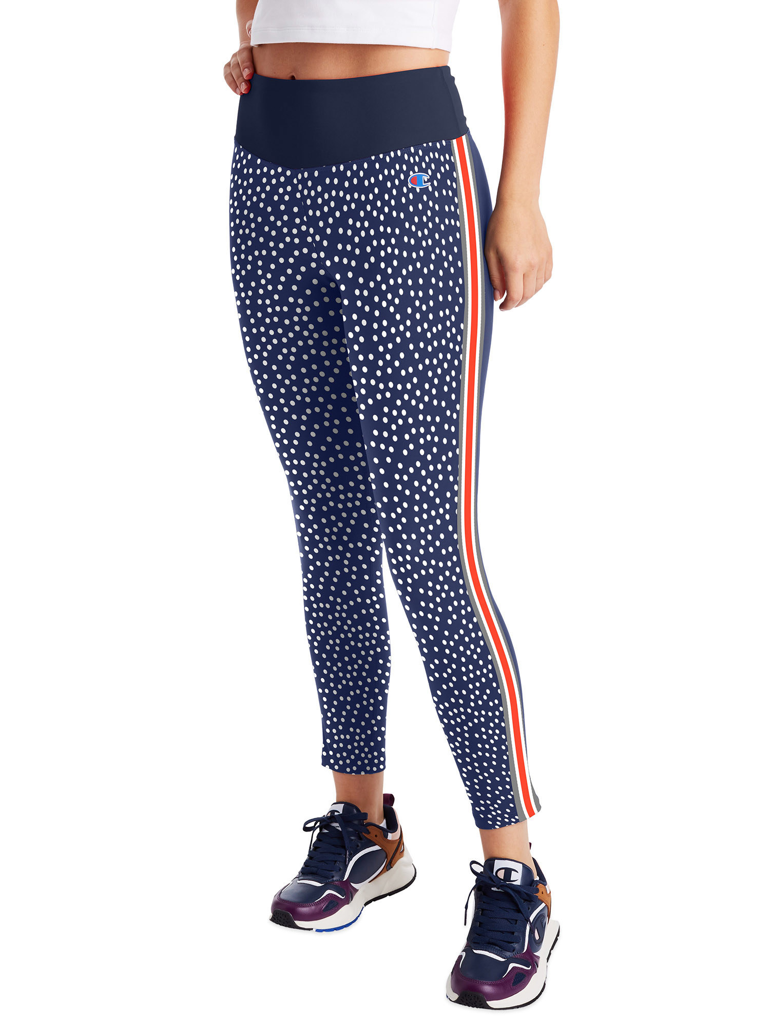 model wearing navy blue and white dotted leggings with red stripe