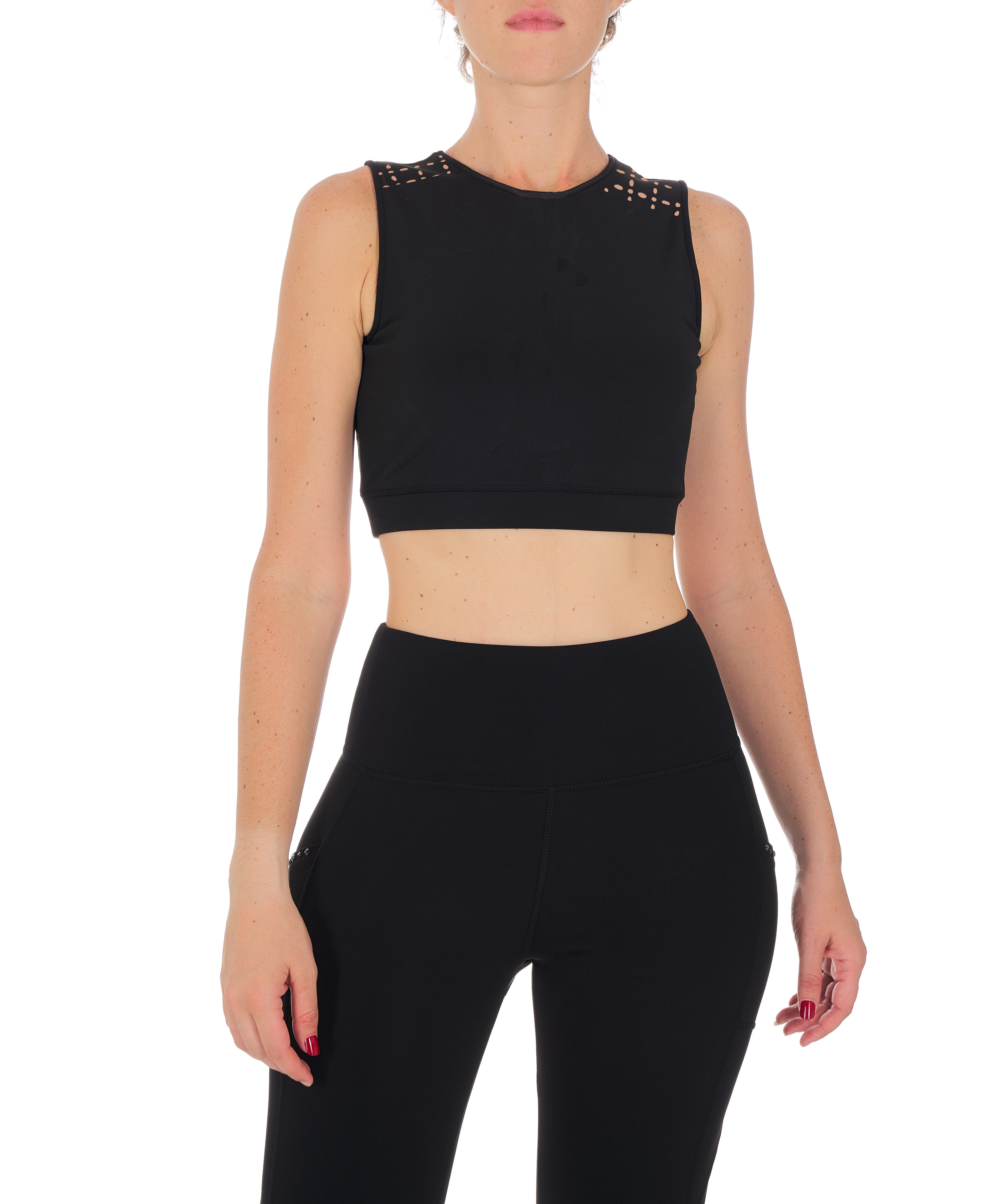 model wearing black crop sports bra