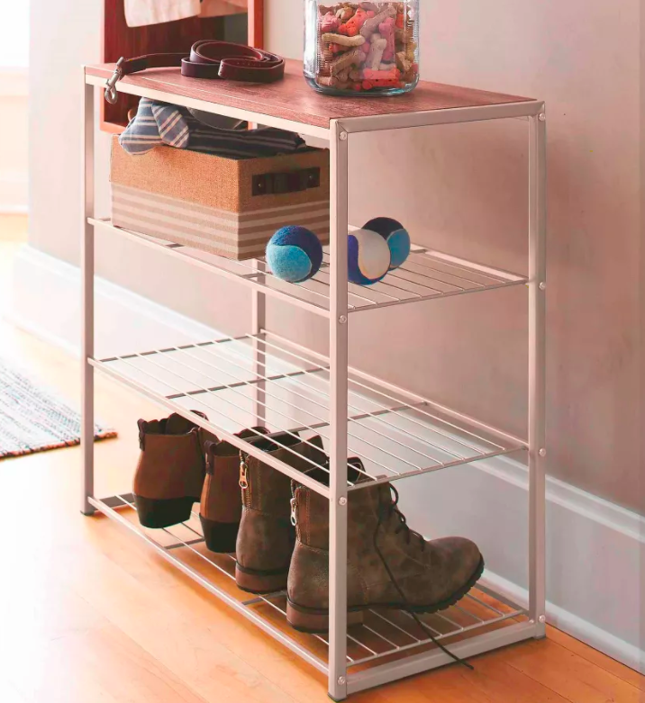 Minimalist white shoe rack with wooden surface