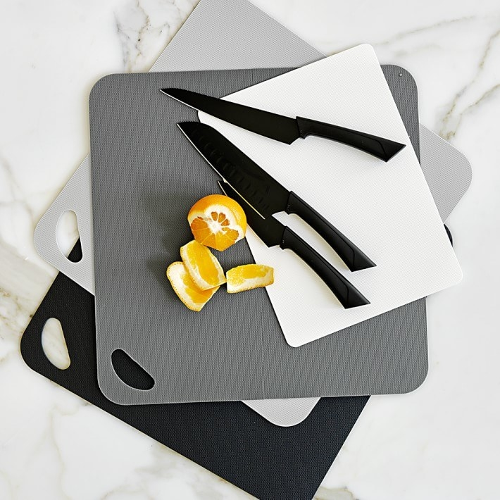 Black, white, and grey cutting boards