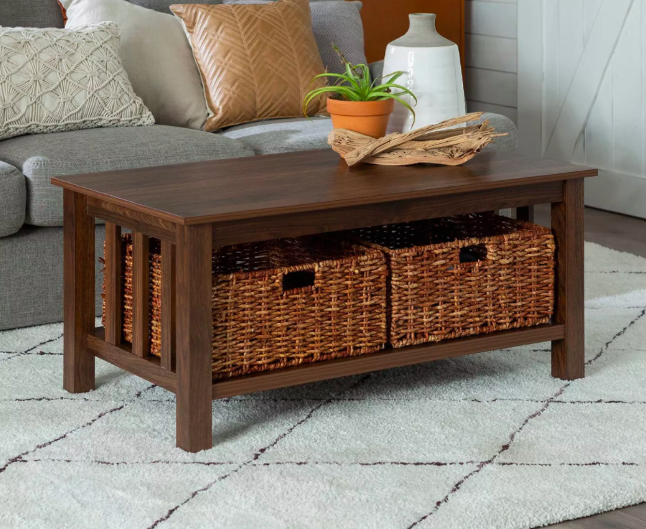 Wooden coffee table with two wicker baskets in understorage space