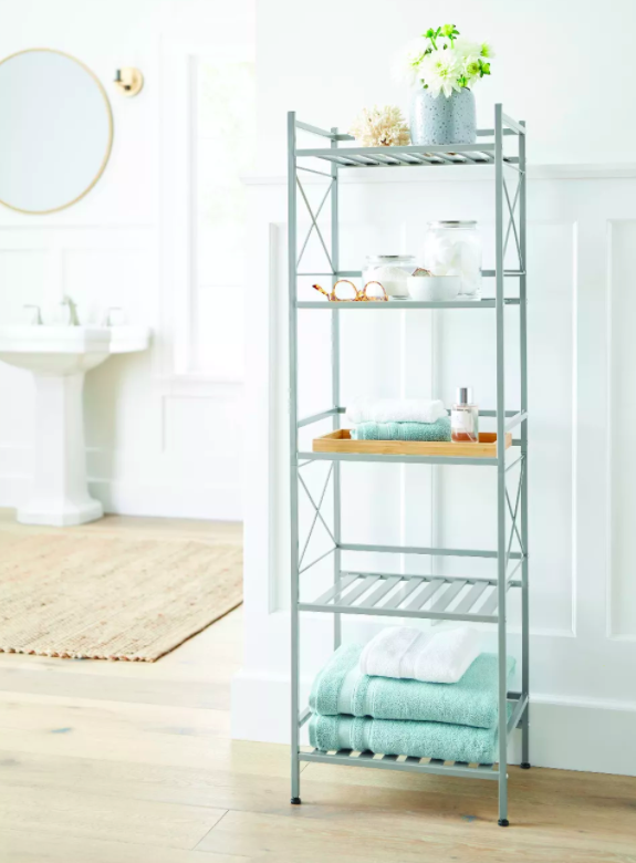 Five-tier decorative shelf in metal with bathroom towels and plants