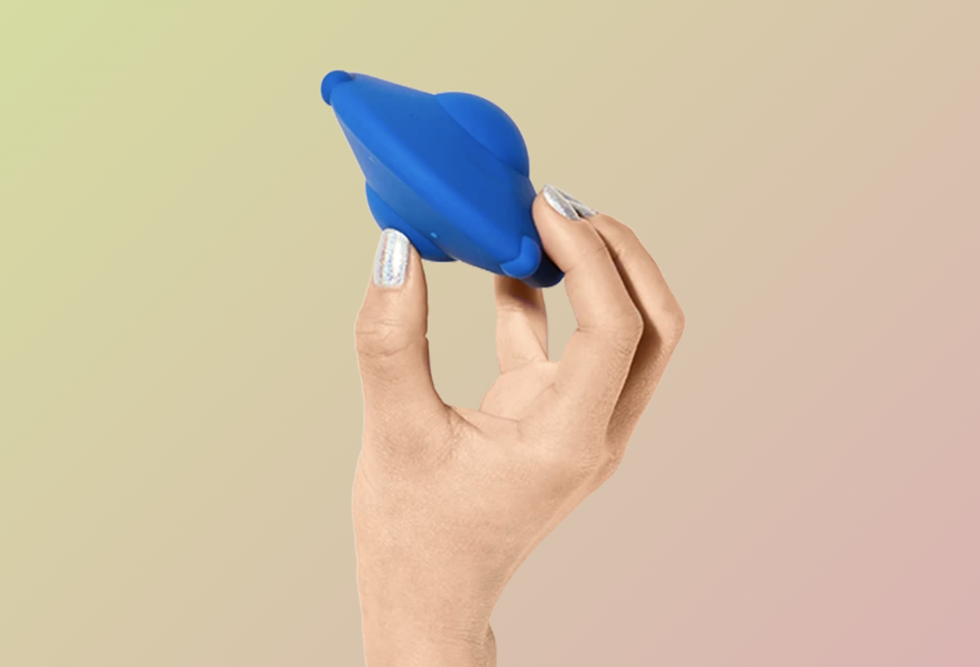 Hand holding UFO-shape vibrator