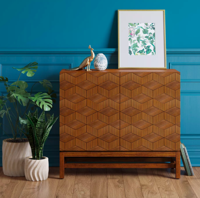 Wooden storage cabinet with geometric-cube design on doors