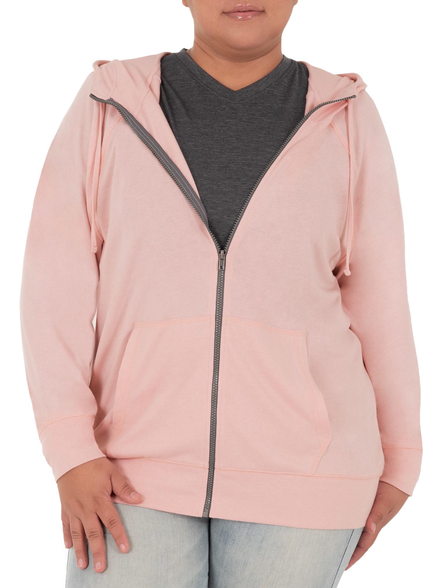 model wearing light pink zip-up hoodie