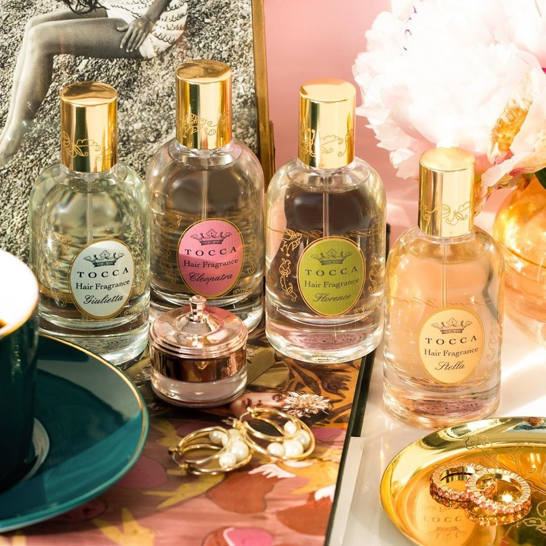 A vanity counter with four differently-scented of hair fragrance