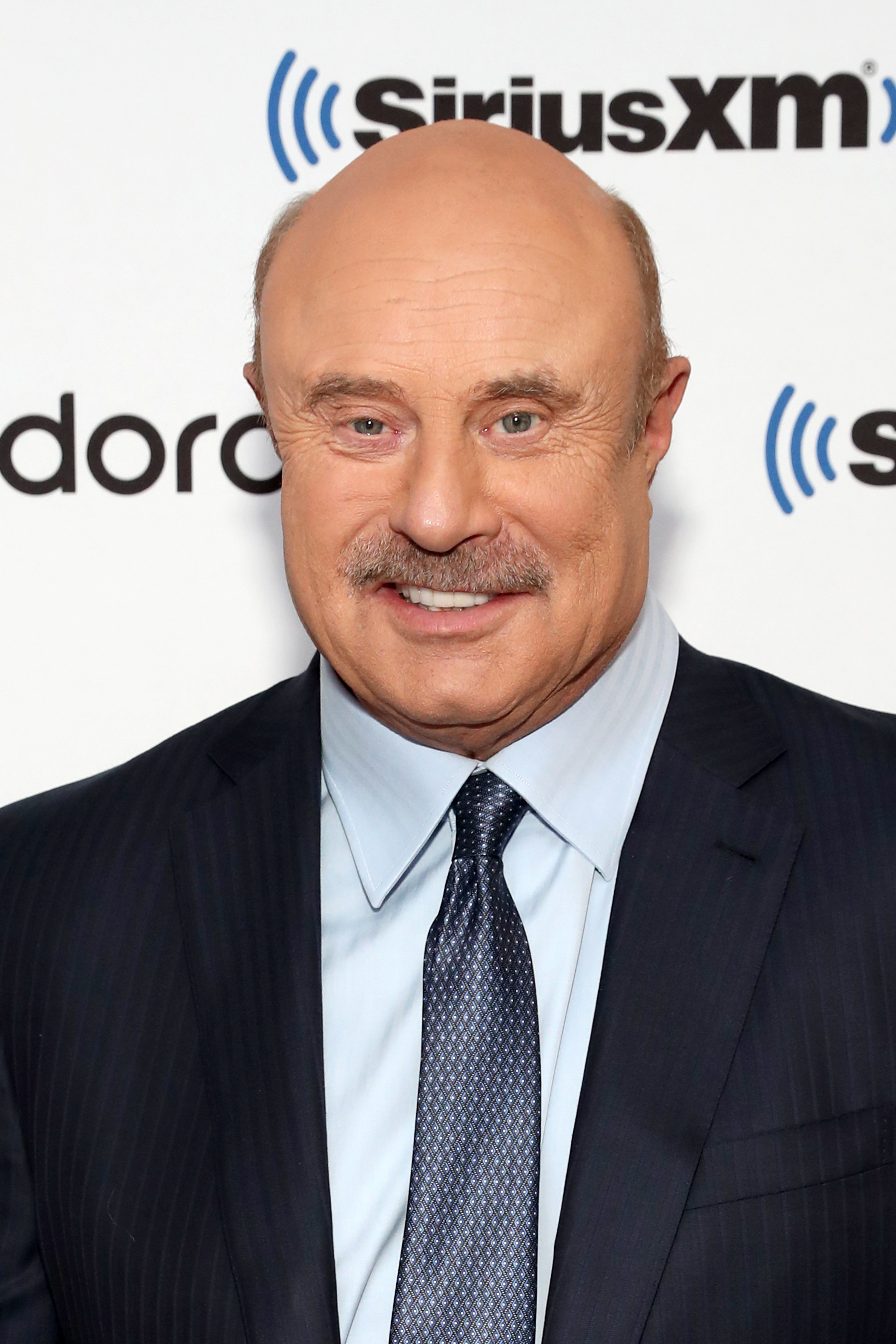 dr. phil in a suit