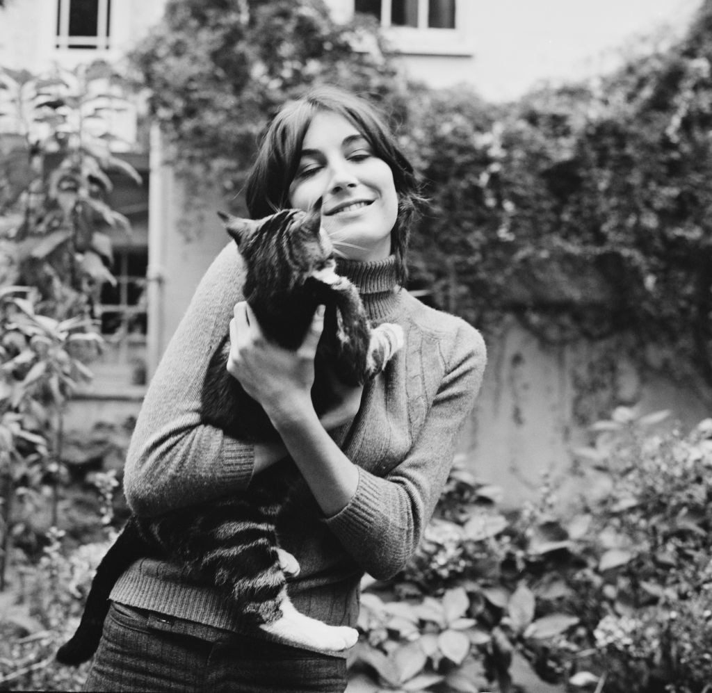 Anjelica Huston with a cat