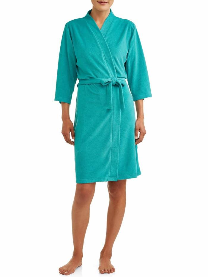 A model in a teal bathrobe
