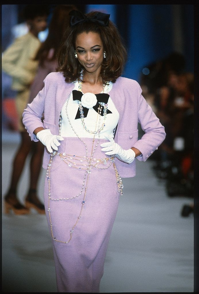 on a runway as a model