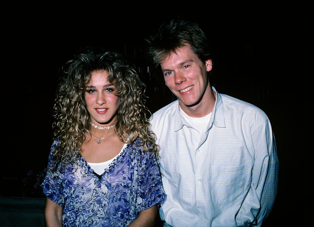Sarah with big '80s hair with Kevin Bacon
