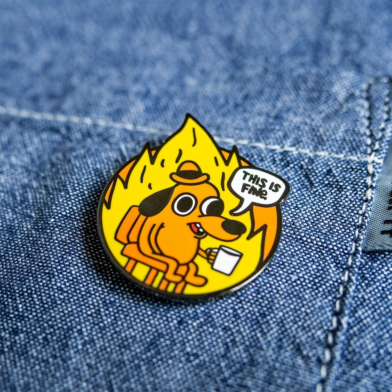 The This is Fine enamel pin.
