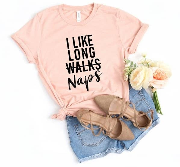 "A shirt that says ""I Like Long Walks (with walks crossed out) Naps"""