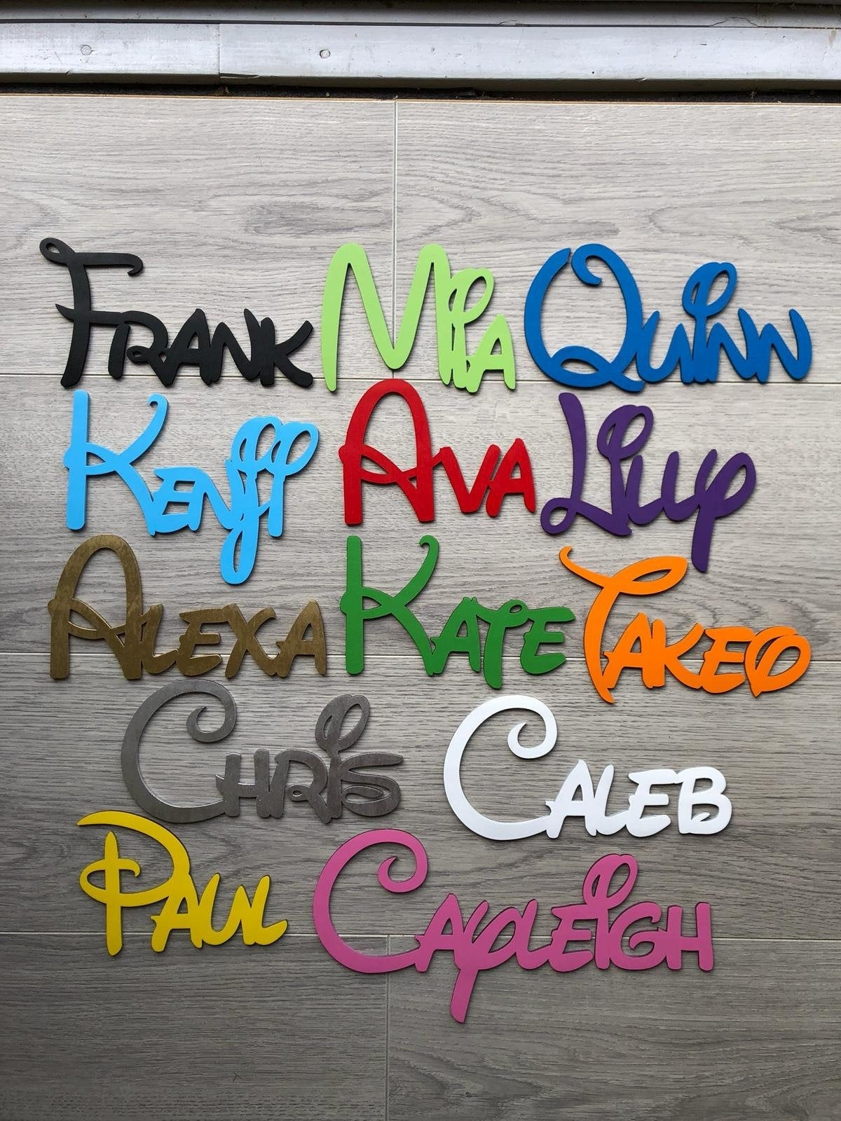 A variety of names spelled out using the Disney font in a variety of color.