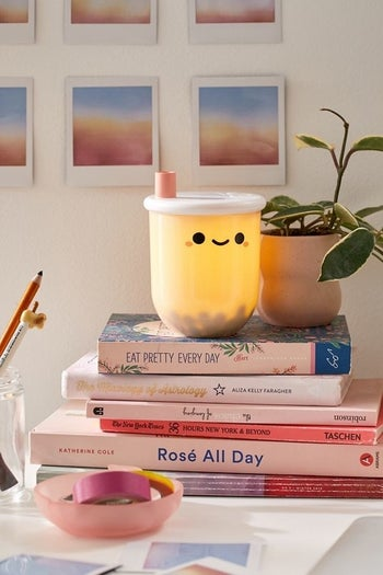 the lamp on top of books