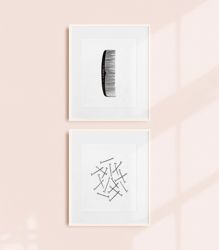 a framed piece of art of a simple black comb and another framed piece of art of scattered bobby pins