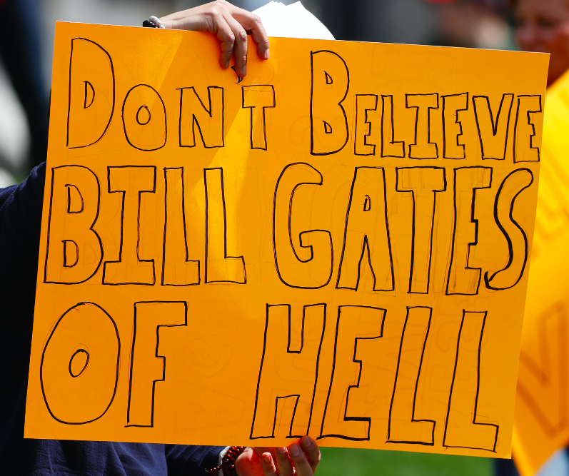 """Sign reading, """"Don't believe Bill Gates of hell"""""""
