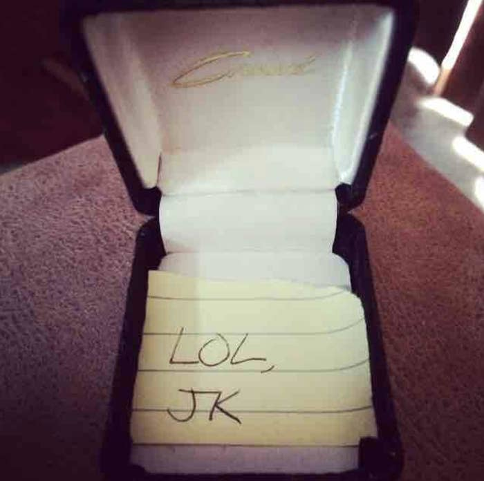 A ring box with a note that says lol jk