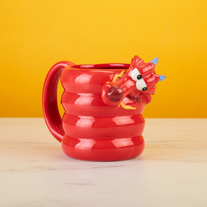 mug that looks like mushu wrapped in a circle