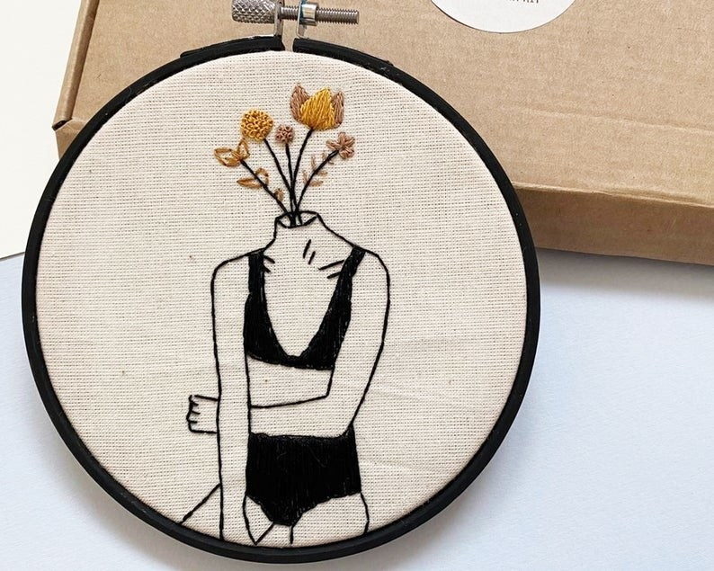 Person's body in bra and panties with flowers for a head