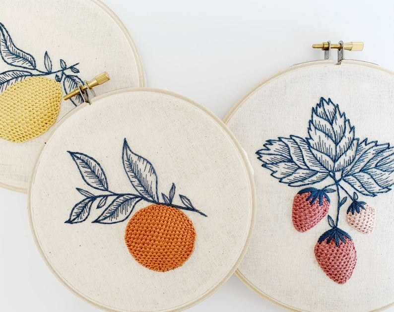 Knitted fruit with embroidered leaves