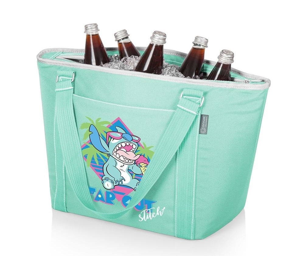 """The mint green tote with a retro design of a sunglasses-wearing Stitch eating an ice cream cone with the text """"Far out Stitch"""""""