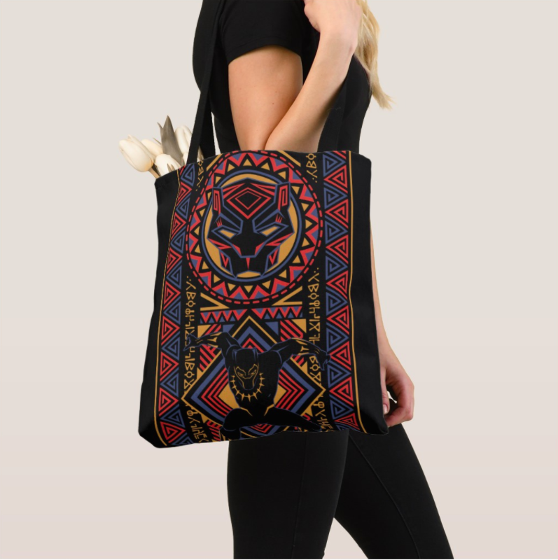 The bag in black, featuring colorful patterns and a Black Panther graphic