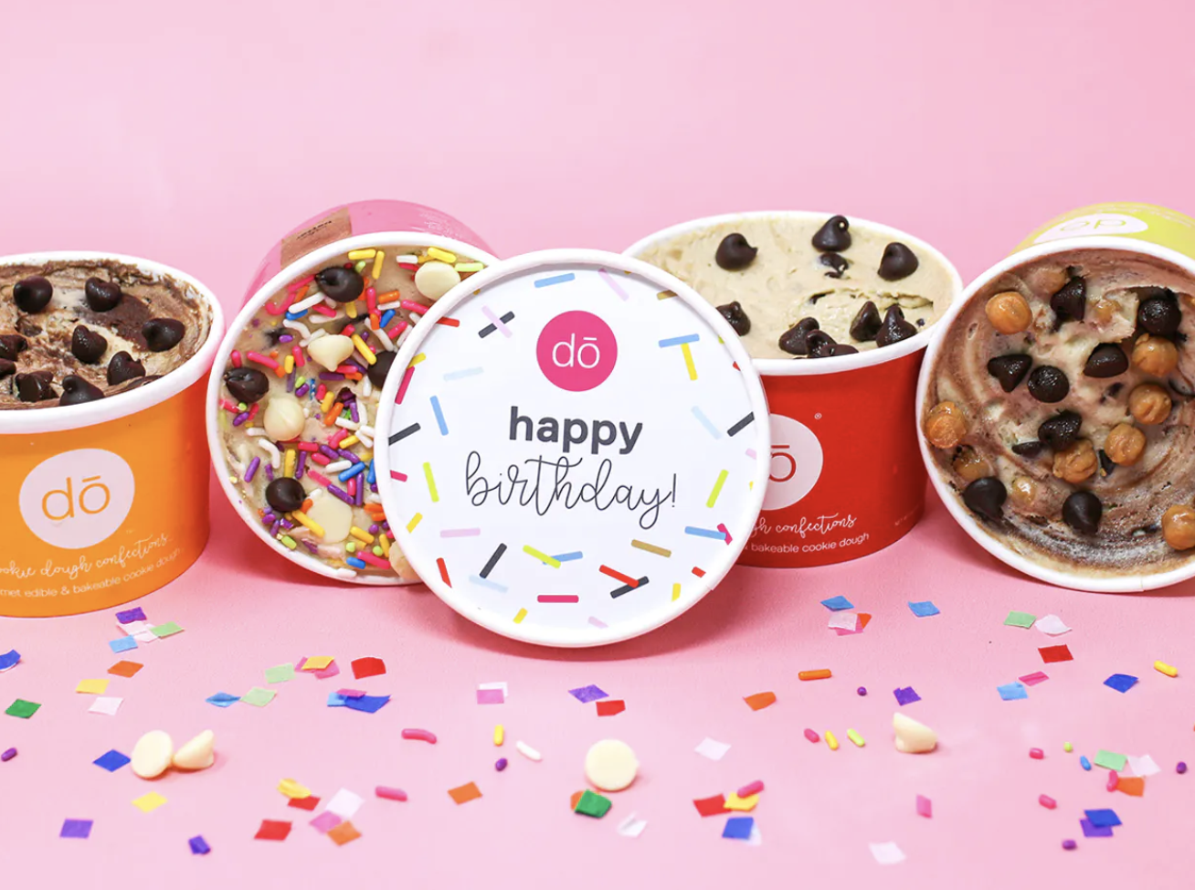 """The tubs of cookie dough with a lid that says """"happy birthday"""""""