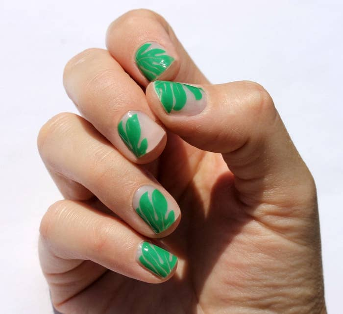 fingernails with green palm tree and pink solid background nail wraps