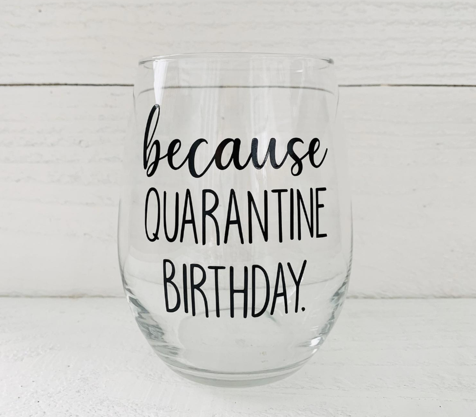 A transparent wine glass with opaque text