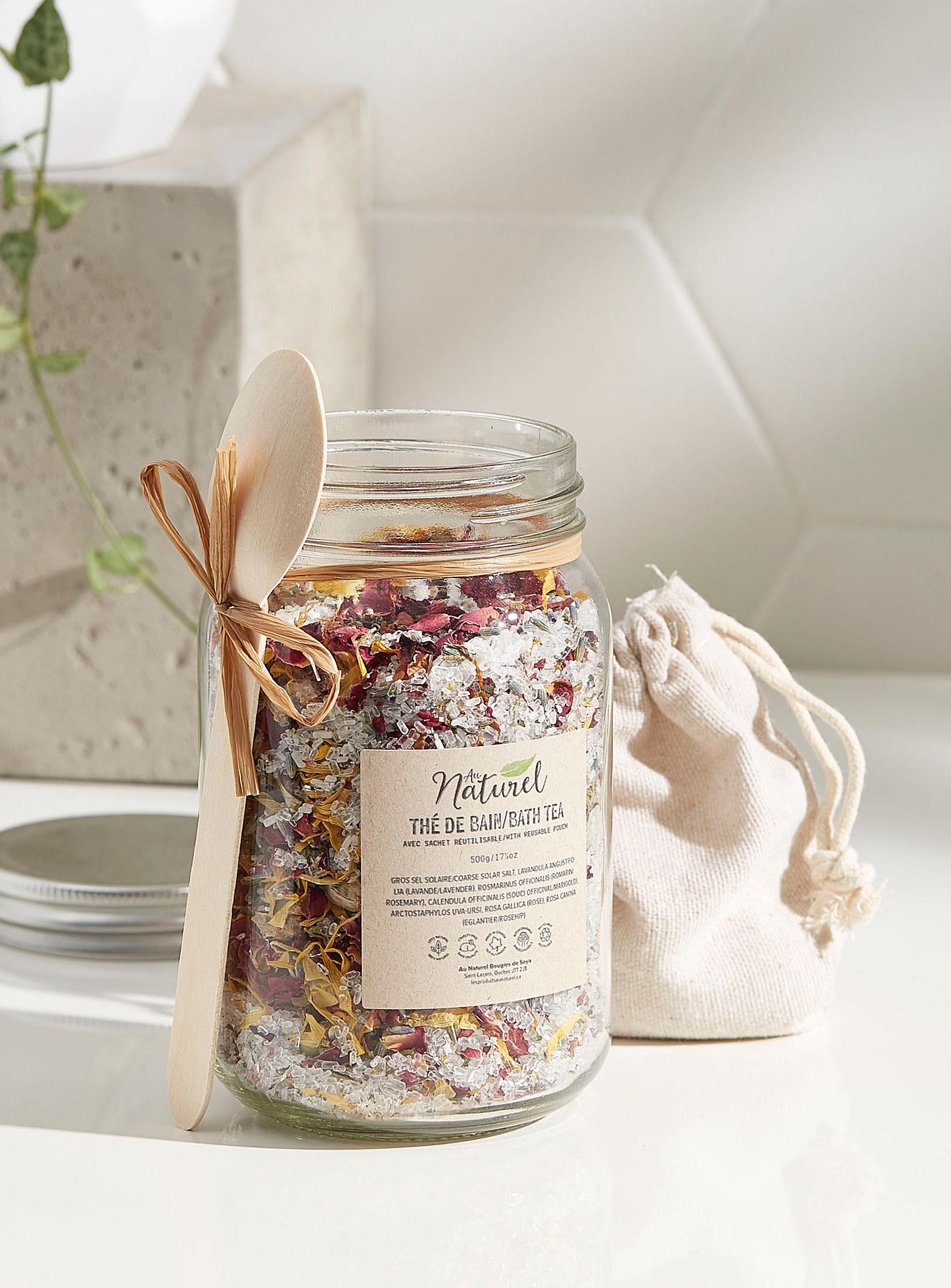 A mason jar filled with a bath soak with a spoon