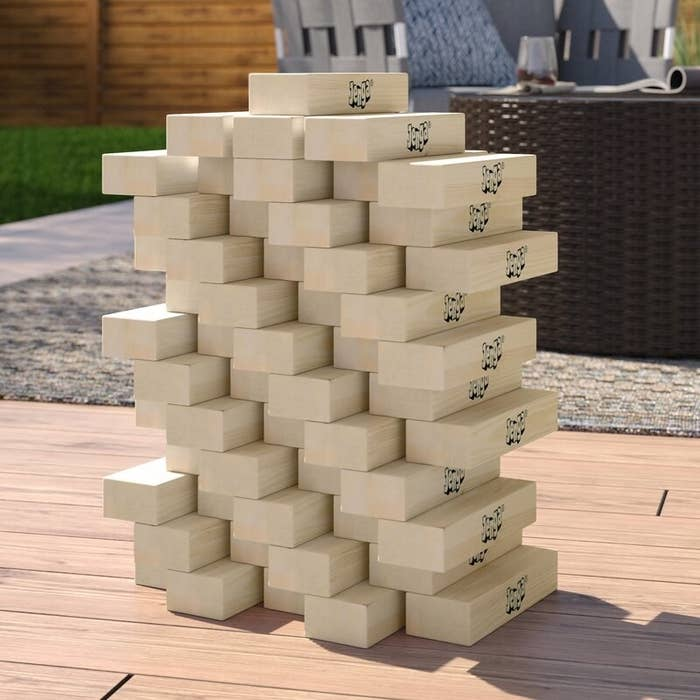 A set of large wooden Jenga blocks stacked up