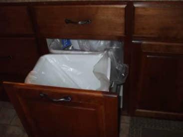 Wood paneled trash drawer