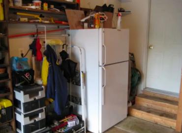 A white fridge in a garage