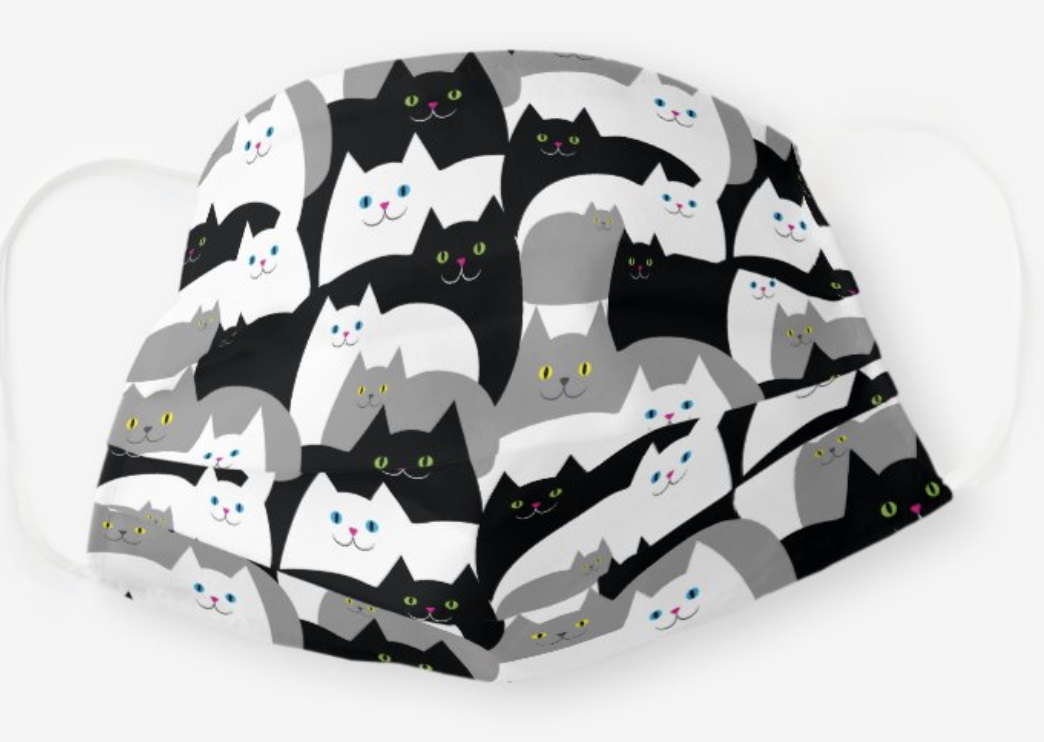 A mask with cartoon white, black, and gray cats